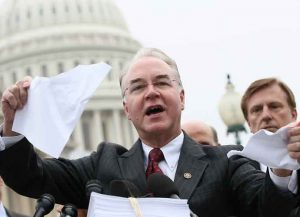 ARLINGTON, VA - MARCH 20: U.S. Rep. Tom Price (R-GA) tears a page from the national health care bill during a press conference at the U.S. Capitol March 21, 2012 in Washington, DC. Republican members from the House of Representatives gatherered to speak out against the health care bill which is the topic of a case before the Supreme Court next week. (Photo by Win McNamee/Getty Images)