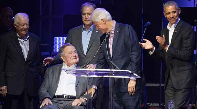 OLLEGE STATION, TX - OCTOBER 21: (L-R) Former United States Presidents Jimmy Carter, George H.W. Bush, George W. Bush, Bill Clinton, and Barack Obama address the audience during the 'Deep from the Heart: The One America Appeal Concert' at Reed Arena on the campus of Texas A&M University on October 21, 2017 in College Station, Texas. (Photo by Rick Kern/Getty Images for Ford Motor Company)