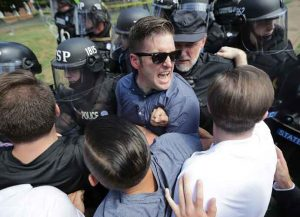 CHARLOTTESVILLE, VA - AUGUST 12: White nationalist Richard Spencer (C) and his supporters clash with Virginia State Police in Emancipation Park after the 'Unite the Right' rally was declared an unlawful gathering August 12, 2017 in Charlottesville, Virginia. Hundreds of white nationalists, neo-Nazis and members of the 'alt-right' clashed with anti-fascist protesters and police as they attempted to hold a rally in Emancipation Park, where a statue of Confederate General Robert E. Lee is slated to be removed. (Photo by Chip Somodevilla/Getty Images)