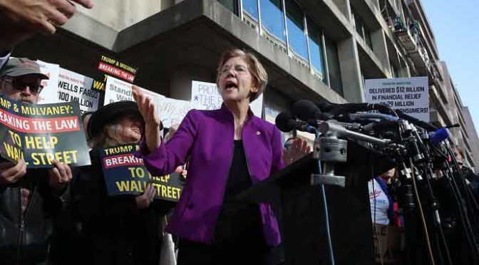 WASHINGTON, DC - NOVEMBER 28: Sen. Elizabeth Warren (D-MA) speaks during a protest in front of the Consumer Financial Protection Bureau (CFPB) headquarters on November 28, 2017 in Washington, DC. Sen. Warren is demanding that Mick Mulvaney step aside and let acting CFPB director Leandra English do her job. President Trump named Office of Management and Budget (OMB) Director Mick Mulvaney to replace outgoing CFPB Director Richard Cordray. (Photo by Mark Wilson/Getty Images)