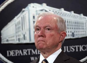 WASHINGTON, DC - JULY 13: U.S. Attorney General Jeff Sessions listens during a news conference to announce significant law enforcement actions July 13, 2017 at the Justice Department in Washington, DC. Attorney General Jeff Sessions held the news conference to announce the 2017 health care fraud takedown.