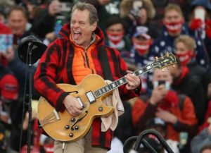 LANSING, MICHIGAN - OCTOBER 27: Entertainer and Michigan native Ted Nugent -- also known as the Motor City Madman -- performs the Star Spangled Banner during a campaign rally for U.S. President Donald Trump at Capital Region International Airport October 27, 2020 in Lansing, Michigan. With one week until Election Day, Trump is campaigning in Michigan, a state he won in 2016 by less than 11,000 votes, the narrowest margin of victory in the state's presidential election history. (Photo by Chip Somodevilla/Getty Images)