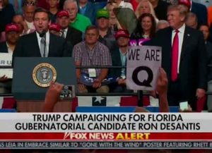 QAnon poster at Trump Rally (Photo: YouTube)