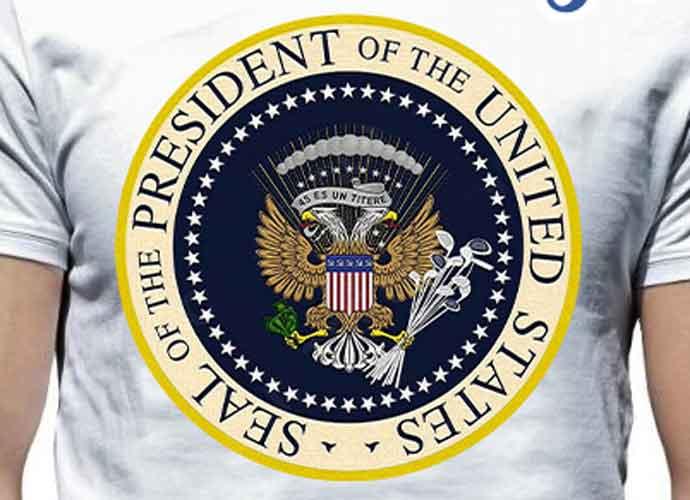 Trump Speaks In Front Of Fake Presidential Seal Mocking Him By Designer Charles Leazott