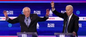 CHARLESTON, SOUTH CAROLINA - FEBRUARY 25: Democratic presidential candidate Sen. Bernie Sanders (I-VT) (L) speaks as former Vice President Joe Biden reacts during the Democratic presidential primary debate at the Charleston Gaillard Center on February 25, 2020 in Charleston, South Carolina. Seven candidates qualified for the debate, hosted by CBS News and Congressional Black Caucus Institute, ahead of South Carolina's primary in four days. (Image: Getty)