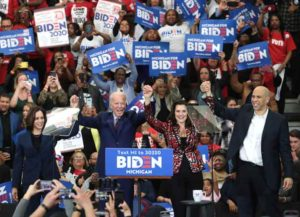 DETROIT, MICHIGAN - MARCH 09: Sen. Kamala Harris (L) (D-CA), Sen. Cory Booker (R)(D-NJ), and Michigan Governor Gretchen Whitmer join Democratic presidential candidate former Vice President Joe Biden on stage at a campaign rally at Renaissance High School on March 09, 2020 in Detroit, Michigan. Michigan will hold its primary election tomorrow. (Image: Getty)