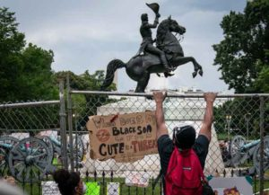 WASHINGTON, DC - JUNE 22: Protesters pull down a fence surrounding the statue of Andrew Jackson in an attempt to pull the statue down in Lafayette Square near the White House on June 22, 2020 in Washington, DC. Protests continue around the country over police brutality, racial injustice and the deaths of African Americans while in police custody.