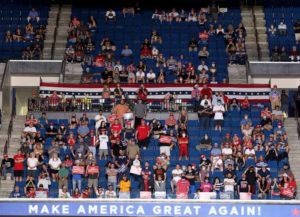 TULSA, OKLAHOMA - JUNE 20: Supporters listen as U.S. President Donald Trump speaksat a campaign rally at the BOK Center, June 20, 2020 in Tulsa, Oklahoma. Trump is holding his first political rally since the start of the coronavirus pandemic at the BOK Center today while infection rates in the state of Oklahoma continue to rise.