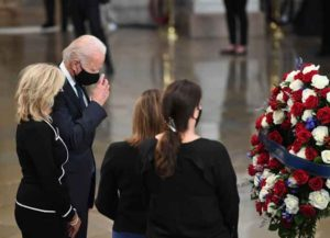 WASHINGTON, DC - JULY 27: Democratic presidential candidate, former Vice President Joe Biden and wife Jill Biden pay their respects at the casket of Rep. John Lewis (D-GA) at Rotunda of the U.S. Capitol for a memorial service on July 27, 2020 in Washington, DC. Lewis, a civil rights icon and fierce advocate of voting rights for African Americans, will lie in state at the Capitol. Lewis died on July 17 at the age of 80.