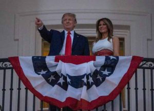 "WASHINGTON, DC - JULY 04: President Donald Trump and first Lady Melania Trump watch fireworks at the White House on July 04, 2020 in Washington, DC. President Trump is hosting a ""Salute to America"" celebration that includes flyovers by military aircraft and a large fireworks display."