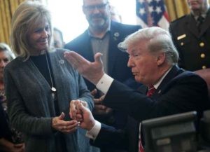 WASHINGTON, DC - MARCH 15: U.S. President Donald Trump (R) greets Angel Mom Mary Ann Mendoza (L) of Mesa Arizona, during an event on border security in the Oval Office of the White House March 15, 2019 in Washington, DC. President Trump has vetoed the congressional resolution that blocks his national emergency declaration on the southern border
