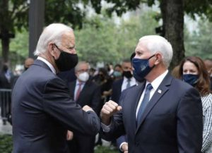 NEW YORK, NEW YORK - SEPTEMBER 11: Democratic presidential nominee Joe Biden (L) and U.S. Vice President Mike Pence (R) greet each other during a 9/11 memorial service at the National September 11 Memorial and Museum on September 11, 2020 in New York City.