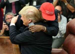 WASHINGTON, DC - OCTOBER 11: (AFP OUT) U.S. President Donald Trump hugs rapper Kanye West during a meeting in the Oval office of the White House on October 11, 2018 in Washington, DC.