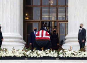 WASHINGTON, DC - SEPTEMBER 24: U.S. President Donald Trump and first lady Melania Trump pay their respects to Associate Justice Ruth Bader Ginsburg's flag-draped casket on the Lincoln catafalque on the west front of the U.S. Supreme Court September 24, 2020 in Washington, DC. A pioneering lawyer and according the Chief Justice John Roberts 'a jurist of historic stature,' Ginsburg died September 18 at the age of 87 after a long battle against cancer.