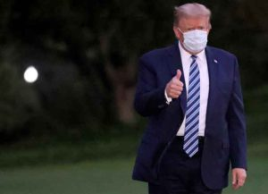 WASHINGTON, DC - OCTOBER 05: U.S. President Donald Trump gestures upon return to the White House from Walter Reed National Military Medical Center on October 05, 2020 in Washington, DC. Trump spent three days hospitalized for coronavirus.