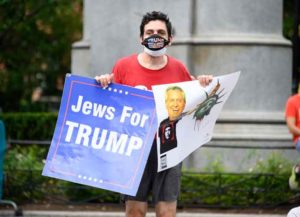 NEW YORK, NEW YORK - AUGUST 22: A person holds up a sign in support of Donald Trump in Union Square during Phase 4 of re-opening following restrictions imposed to slow the spread of coronavirus on August 22, 2020 in New York City. The fourth phase allows outdoor arts and entertainment, sporting events without fans and media production.