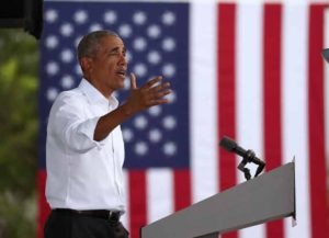 NORTH MIAMI, FLORIDA - OCTOBER 24: Former President Barack Obama speaks in support of Democratic presidential nominee Joe Biden during a drive-in rally on October 24, 2020 in North Miami, Florida. Mr. Obama is campaigning for his former Vice President before the Nov. 3rd election. (Image: Getty)