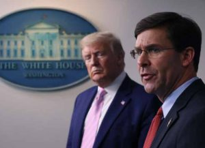 WASHINGTON, DC - APRIL 01: Secretary of Defense Mark Esper speaks as U.S. President Donald Trump listens during the daily White House coronavirus press briefing April 1, 2020 in Washington, DC. After announcing yesterday that COVID-19 could kill between 100,000 and 240,000 Americans, the Trump administration is also contending with the economic effects of the outbreak as the stock market continues to fall, businesses remain closed, and companies lay off and furlough employees.