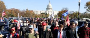 "WASHINGTON, DC - NOVEMBER 14: People participate in the ""Million MAGA March"" from Freedom Plaza to the Supreme Court, on November 14, 2020 in Washington, DC. Supporters of U.S. President Donald Trump marching to protest the outcome of the 2020 presidential election"