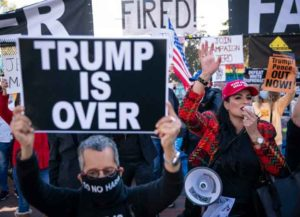 WASHINGTON, DC - NOVEMBER 13: Supporters of U.S. President Donald Trump and counter protesters demonstrate outside of the White House ahead of Saturday's Million MAGA March on November 13, 2020 in Washington, DC. Supporters clashed with protesters organized by Shutdown DC at Black Lives Matter Plaza.