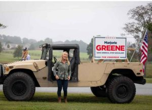 DALLAS, GA - OCTOBER 15: Georgia Republican House candidate Marjorie Taylor Greene and Sen. Kelly Loeffler (R-GA) arrive at a press conference in a Humvee during which Greene endorsed Loeffler on October 15, 2020 in Dallas, Georgia. Greene has been the subject of some controversy recently due to her support for the right-wing conspiracy group QAnon. (Photo: Getty)