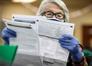 DENVER, CO - NOVEMBER 03: Election judge Bonnie Carr of Denver, Colorado pours over a ballot as she prepares them to be counted at the Denver Elections Division Building on November 3, 2020 in Denver, Colorado. After a record-breaking early voting turnout, Americans head to the polls on the last day to cast their vote for incumbent U.S. President Donald Trump or Democratic nominee Joe Biden in the 2020 presidential election. (Image: Getty)