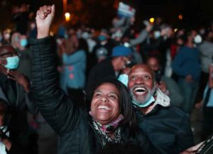 WILMINGTON, DELAWARE - NOVEMBER 07: Jailyn Banks and King M celebrate as President-elect Joe Biden arrives on stage at the Chase Center to address the nation on November 07, 2020 in Wilmington, Delaware. After four days of counting the high volume of mail-in ballots in key battleground states due to the coronavirus pandemic, the race was called for Biden after a contentious election battle against incumbent Republican President Donald Trump.