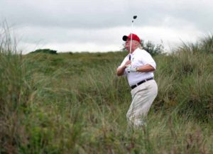 ABERDEEN, SCOTLAND - JULY 10: Donald Trump plays a round of golf after the opening of The Trump International Golf Links Course on July 10, 2012 in Balmedie, Scotland. The controversial £100m course opens to the public on Sunday July 15. Further plans to build hotels and homes on the site have been put on hold until a decision has been made on the building of an offshore windfarm nearby. (Photo: Getty)