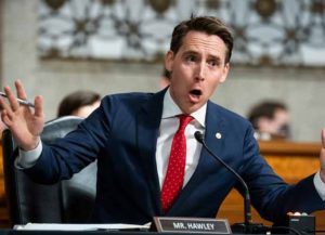 WASHINGTON, DC - JUNE 03: U.S. Sen. Josh Hawley (R-MO) questions former Deputy Attorney General Rod Rosenstein at hearing of the Judiciary Committee on Capitol Hill on June 03, 2020 in Washington, DC. The Republican-led panel is exploring issues raised with warrants issued in the FBI investigation, code named Crossfire Hurricane at the time, of Trump campaign officials in the 2016 presidential race.