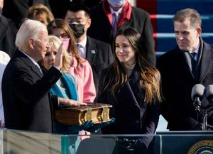 WASHINGTON, DC - JANUARY 20: Joe Biden is sworn in as the 46th president of the United States by Chief Justice John Roberts as Jill Biden holds the Bible during the the 59th inaugural ceremony on the West Front of the U.S. Capitol on January 20, 2021 in Washington, DC. During today's inauguration ceremony Joe Biden becomes the 46th president of the United States. (Photo by Patrick Semansky-Pool/Getty Images)
