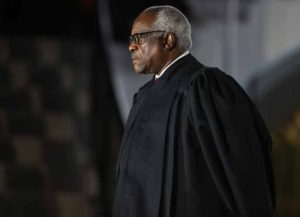 WASHINGTON, DC - OCTOBER 26: Supreme Court Associate Justice Clarence Thomas attends the ceremonial swearing-in ceremony for Amy Coney Barrett to be the U.S. Supreme Court Associate Justice on the South Lawn of the White House October 26, 2020 in Washington, DC. The Senate confirmed Barrett's nomination to the Supreme Court today by a vote of 52-48. (Photo by Tasos Katopodis/Getty Images)
