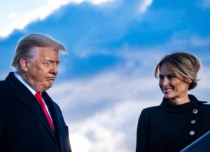 JOINT BASE ANDREWS, MARYLAND - JANUARY 20: President Donald Trump and First Lady Melania Trump pause while speaking to supporters at Joint Base Andrews before boarding Air Force One for his last time as President on January 20, 2021 in Joint Base Andrews, Maryland. Trump, the first president in more than 150 years to refuse to attend his successor's inauguration, is expected to spend the final minutes of his presidency at his Mar-a-Lago estate in Florida. (Photo by Pete Marovich - Pool/Getty Images)
