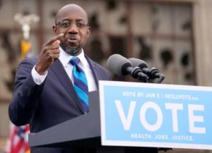 ATLANTA, GA - DECEMBER 15: U.S. Democratic Senate candidate Raphael Warnock delivers remarks during a campaign rally with U.S. President-elect Joe Biden at Pullman Yard on December 15, 2020 in Atlanta, Georgia. Biden's stop in Georgia comes less than a month before the January 5 runoff election for Senate candidates Warnock and Ossoff as they try to unseat Republican incumbents Sen. David Perdue and Sen. Kelly Loeffler.  (Photo by Drew Angerer/Getty Images)