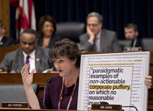 """Representative Katie Porter, a Democrat from California, questions Tim Sloan, president and chief executive officer of Wells Fargo & Co., not pictured, during a House Financial Services Committee hearing in Washington, D.C., U.S., on Tuesday, March 12, 2019. Wells Fargo & Co. stock is underperforming Tuesday pre-market as Sloan prepares to appear before a House committee focused on what it's calling a """"pattern of consumer abuses."""" Photographer: Andrew Harrer/Bloomberg via Getty Images"""