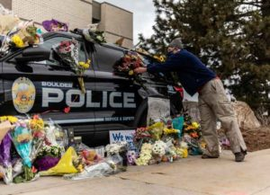BOULDER, CO - MARCH 23: Mourners pay their respects to Officer Eric Talley, who was killed after a gunman opened fire at a King Sooper's grocery store on March 23, 2021 in Boulder, Colorado. (Photo by Chet Strange/Getty Images)