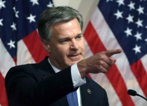 WASHINGTON, DC - JUNE 14: FBI Director is Christopher A. Wray speaks to the media during a news conference at FBI Headquarters, on June 14, 2018 in Washington, DC. Earlier today the inspector general released a 500 page report on the Clinton email investigation. (Photo by Mark Wilson/Getty Images)