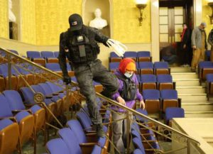'Zip Tie Guy' Eric Munchel in the Senate Chamber during the Capitol Riots (Image: Getty)