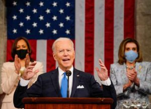 WASHINGTON, DC - APRIL 28: President Joe Biden addresses a joint session of Congress, with Vice President Kamala Harris and House Speaker Nancy Pelosi (D-CA) on the dais behind him on April 28, 2021 in Washington, DC. On the eve of his 100th day in office, Biden spoke about his plan to revive America's economy and health as it continues to recover from a devastating pandemic. He delivered his speech before 200 invited lawmakers and other government officials instead of the normal 1600 guests because of the ongoing COVID-19 pandemic. (Photo by Melina Mara-Pool/Getty Images)