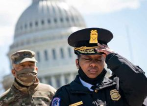WASHINGTON, DC - APRIL 2: Acting Capitol Police Chief Yogananda Pittman (R) attends a press briefing about the security incident at the U.S. Capitol on April 2, 2021 in Washington, DC. Pittman announced that one police officer is dead after a man rammed his vehicle into a Capitol barricade. The suspect was fatally shot by police during the incident. (Photo by Drew Angerer/Getty Images)