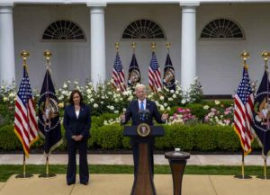 U.S. President Joe Biden, right, and U.S. Vice President Kamala Harris applaud after speaking in the Rose Garden of the White House in Washington, D.C., U.S., on Thursday, May 13, 2021. Fully vaccinated Americans can do away with wearing masks, the head of the U.S. Centers for Disease Control and Prevention said today, the most significant shift in federal guidelines since the start of the pandemic. Photographer: Tasos Katopodis/UPI/Bloomberg via Getty Images