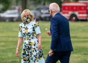 WASHINGTON, DC - APRIL 29: U.S. President Joe Biden picks a dandelion for first lady Jill Biden as they walk to Marine One on the Ellipse near the White House on April 29, 2021 in Washington, DC. President Biden and the first lady will spend the day in Georgia to commemorate the first 100 days in office and to visit former President Jimmy Carter. (Photo by Sarah Silbiger/Getty Images)