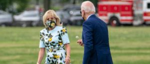 WASHINGTON, DC - APRIL 29: (EDITOR'S NOTE: Alternate crop) U.S. President Joe Biden picks a dandelion for first lady Jill Biden as they walk to Marine One on the Ellipse near the White House on April 29, 2021 in Washington, DC. President Biden and the first lady will spend the day in Georgia to commemorate the first 100 days in office and to visit former President Jimmy Carter. (Photo by Sarah Silbiger/Getty Images)