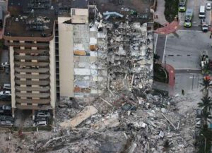 SURFSIDE, FLORIDA - JUNE 24: Search and Rescue personnel work after the partial collapse of the 12-story Champlain Towers South condo building on June 24, 2021 in Surfside, Florida. It is unknown at this time how many people were injured as search-and-rescue effort continues with rescue crews from across Miami-Dade and Broward counties. (Photo by Joe Raedle/Getty Images)