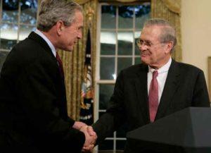 Bush & Rumsfeld shake hands, November 8, 2006 (Image: Wikimedia)