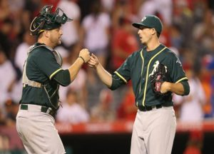 ANAHEIM, CALIFORNIA - AUGUST 04: Closer Ryan Dull #66 and catcher Stephen Vogt #21 of the Oakland Athletics celebrate after Dull got the final out of the 10th inning to pick up the save against the Los Angeles Angels of Anaheim at Angel Stadium of Anaheim on August 4, 2016 in Anaheim, California. The As won 8-6 in 10 innings. (Photo by Stephen Dunn/Getty Images)