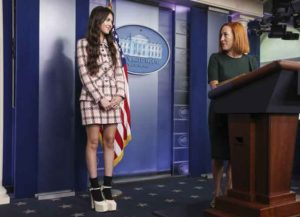 """Jen Psaki, White House press secretary, right, introduces pop star Olivia Rodrigo during a news conference in the James S. Brady Press Briefing Room at the White House in Washington, D.C., U.S., on Wednesday, July 14, 2021. President Biden and the top U.S. immunologist Anthony Fauci are hosting Rodrigo to make the case that vaccines are """"Good 4 U,"""" the title of one of her hit songs. Photographer: Oliver Contreras/Bloomberg via Getty Images"""