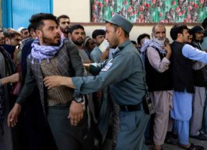 KABUL, AFGHANISTAN - AUGUST 14: Afghans wait in long lines for hours at the passport office as many are desperate to have their travel documents ready to go on August 14, 2021 in Kabul, Afghanistan. Tensions are high as the Taliban advance on the capital city after taking the major cities of Herat, Mazar-e Sharif, and the country's second-largest city Kandahar. (Photo by Paula Bronstein /Getty Images)