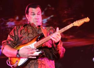 TOKYO, JAPAN - OCTOBER 22: Actor Steven Seagal performs during the abolition of nuclear weapons concert on October 22, 2005 in Tokyo, Japan. The concert is supported by the Global Nuclear Disarmament Fund. (Photo by Koichi Kamoshida/Getty Images)